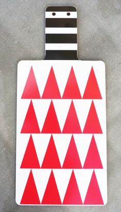 Red triangle, cuttingboard with a handle by Camilla Engdahl #nordicdesigncollective #camillaengdahl #triangle #red #black #stripe #stripes #white #kitchen #cut #cook #cuttingboard #graphicalpatterns #patterns #pattern