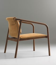 Oslo chair by Angell Wyller Aarseth for Bernhardt Design. Manufactured in North Carolina, the walnut frame with a sling back and seat mar...