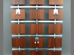 Danish Wall Mounted Coat and Hat Rack - Mid-Century Danish wall mounted Aluminium & Teak Coat and Hat Rack. The rack includes a teak slatted shelf which fixes to the top for hats and umbrellas. A very cool addition to any hallway adding a sense of style.
