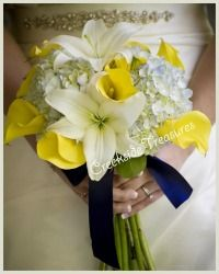yellow and white bouquet with a touch of blue...would love more blue and less yellow