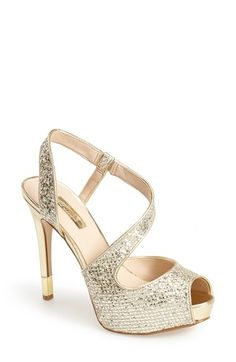Free shipping and returns on GUESS 'Hilariely' Platform Sandal (Women) at Nordstrom.com. All that glitters is gold and silver on this sultry peep-toe sandal styled with a curving strap and a standout metallic heel.