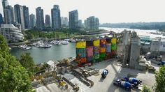 OSGEMEOS finished the gigantic 360 degrees mural, that is now part of the Granville Island's landscape, in Vancouver, Canada (2014)