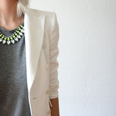 Dress up a plain gray tee with a blazer and a statement necklace.