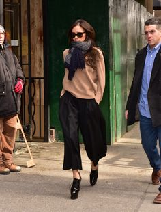 Paired with cold-weather accessories and a cozy sweater, Victoria's culottes added a sophisticated element to her dressed-up daytime look. Source: Getty / James Devaney