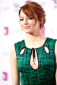 Emma Stone Photos - Actress Emma Stone arrives at the 17th Annual Critics' Choice Movie Awards held at The Hollywood Palladium on January 12, 2012 in Los Angeles, California. - 17th Annual Critics' Choice Movie Awards - Red Carpet