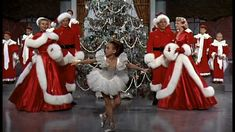 "From the 1954 movie White Christmas here's Bing with Danny Kay, Rosemary Clooney, and Vera-Ellen singing  ""White Christmas""  ."
