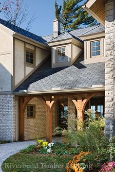Inviting entry ways are one architectural characteristic of a traditional timber frame home.