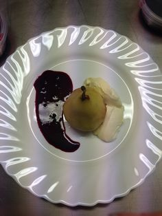Poached pear with blackberry Coulis and chantilly cream