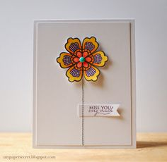 """Stamp and color a lacy flower and pop it out on a handmade """"miss you"""" card.  The stem has been stitched right onto the front."""