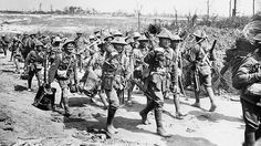 Exhausted machine-gunners passing Casualty Corner after coming out of Poziers, France, in 1916 durring WWI. Picture: Australian War Memorial.