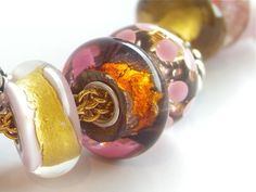 """Golden cave"" by Trollbeads brings to mind molten rose gold..."