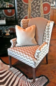 This chevron upholstery brings a modern edge to a traditional wing-back chair. | Houston,TX | Gallery Furniture |