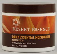 Desert Essence Daily Essential Moisturizer.  Cheap basic no-frills everyday moisturizer works great on my oily acne-prone skin.  Great ingredients and no 'cones...all about $1 per oz.!!