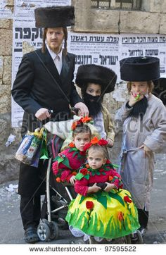JERUSALEM - MAR. 08 : Ultra Orthodox family during Purim in Mea Shearim Jerusalem