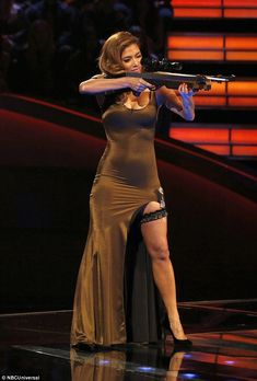 Armed and dangerous: Nicole showed off her incredible figure in a racy dress with a thigh-...