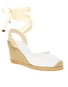 I don't usually like wedges...but I love me some straps...and these are really pretty.