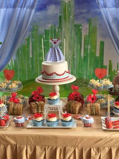 Fantastic backdrop and dessert table at a Wizard of Oz birthday party! See more party planning ideas at CatchMyParty.com!