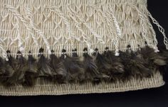 Rare woven baskets known as kete (kit bags) hand-made from Muka (flax fibres) and feathers.