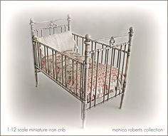 1:12th scale miniature iron crib by Robert  ... quilt and pillow by Monica Roberts