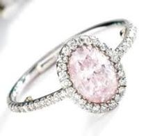 Bague JAR en platine avec diamant rose.