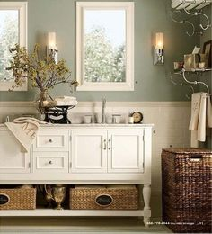 Youngsters Area Home Furnishings Gratifying-Green-By-Sherwin-Williams-Light-Sage-Green-Bathroom-Color-With-White-And-Wicker-Accents. Beautiful Bathrooms, Modern Bathroom, Master Bathroom, Vanity Bathroom, White Bathroom, Bathroom Table, Bathroom Storage, Dresser Vanity, Bathroom Organization