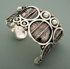 Fold formed with sterling silver rings and pearls.