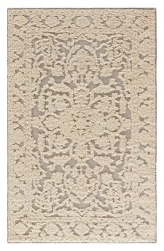 Eye-catching texture makes this lace-inspired rug a stunning addition to the vintage décor.