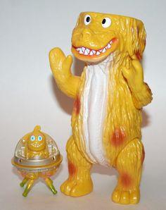 Zollmen Yellow Popy Dog, awesome sofubi! http://www.viciousfun.com/kaiju/zollmen.html