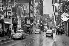 1967. A view of the Leidsestraat with cars in Amsterdam. The Leidsestraat is a busy shopping street located between the Koningsplein and the Leidseplein. The street, which crosses the Herengracht, Keizersgracht and Prinsengracht, dates back to great city expansion of 1658 and ran from the Heiligewegspoort to the Leidsepoort in the direction of the city of Leiden. Since 1971 is the street a pedestrian area closed for all traffic and bicyclists. #amsterdam #1967 #Leidsestraat