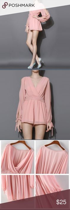 """NWT Pink Chiffon Romper Adorable romper with shoulder slits and ties on the arms. Approx 32"""" long measured flat from top to bottom from the back and """"32 wide measured flat at the waist. Side zip closure. Dresses"""