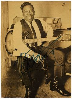American musician of blues, singer, songwriter and guitarist - considered one of the greatest guitar players ever. Signed half-tone photo in sepia tone, probably from a page of a magazine, shown with