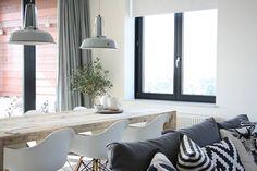 Les couleurs blanc et gris anthracite créent un contraste prononcé dans la déco de ce joli appartement