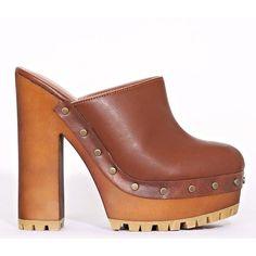 Tess Platform Clogs (€30) ❤ liked on Polyvore featuring shoes, clogs, cognac, wooden platform shoes, faux leather shoes, platform shoes, studded shoes and cognac shoes
