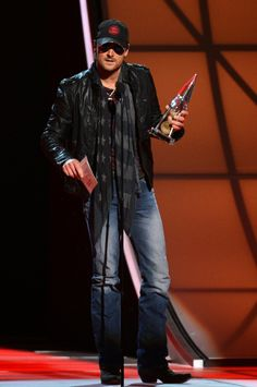 Eric Church accepts the award for Album of the Year. <3 wearin the same clothes from the springsteen video <3