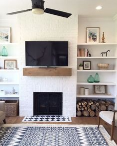 I love this super simple fireplace, mantle and shelves combo. patterned carpet and tile heart. Lots of white and wood. Very scandanavian.