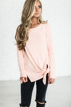 Sometimes you just want a top you can throw on with some leggings or jeans, be comfortable yet still cute. The cute tie detailing makes it super simple to look totally put together without much effort