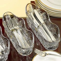 Use long glass dishes for cutlery / flatware on a buffet table