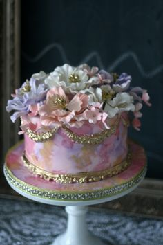Water Colour cake with sugar flowers and gold crown moulding