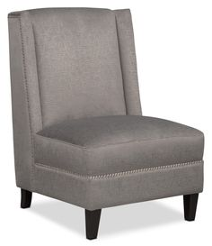 this accent chair speaks volumes with its button tufting bone tone