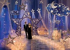 debut ideas Star themed proms are a classic idea and Stumps Prom has tons of celestial themed decorations to make your event look spectacular. Our Make it Last Forever star theme is perfec Starry Night Prom, Prom Night, Starry Nights, Dance Themes, Prom Themes, Star Decorations, Wedding Decorations, School Dance Decorations, Senior Prom