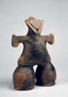 Ceramic Dogu figure. The figurines provide a tantalizing link to the mysterious yet remarkable Jômon people, prehistoric foragers who lived in the temperate forests that covered the Japanese archipelago. The Jômon people appear to have been the first people to use pottery, in a tradition that stretches almost 13 millennia. Dogû developed within this context and about 18,000 figurines have been excavated from sites throughout Japan.