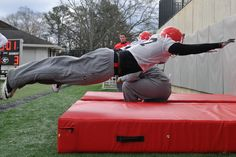 Georgia defensive end Ray Drew (27) dives during a drill during spring NCAA college football practice in Athens, Ga., Saturday, March 2, 2013. (AP Photo/The Banner-Herald, AJ Reynolds)