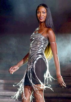 Naomi Campbell models the collection of the Italian stylist Gai Mattiolo on the famous Spanish Steps during the first day of Fashion Week on July 11, 2002 in Rome