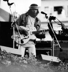 Neil Young playing the SNACK Benefit Concert at Kezar Stadium in San Francisco, March 1975