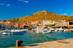 Porto Ercole, Tuscany, Italy. The town is the final resting place of Caravaggio, who died there on his way back to Rome to receive a pardon after being exiled. Photo by Dmitriy Yakovlev/Shutterstock.