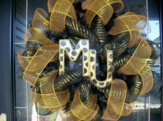 have this mizzou wreath on my door and love it.  (seller is super easy to work with and customize)