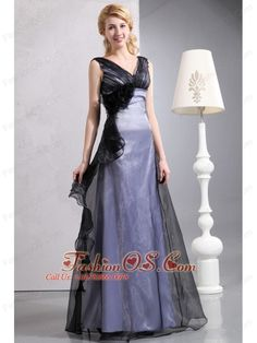 Romantic Black Column V-neck Hand Made Flower Mother Of The Bride Dress Floor-length Organza  http://www.fashionos.com  http://www.facebook.com/quinceaneradress.fashionos.us   Fans of feminine romantic dresses are going to love this dress! It is made from a gorgeous satin fabric with a layer of tulle covered above and features wide straps and a sultry plunging neckline. Down one side of the bodice, a beautiful cascade of fabric roses and ruffles adds a soft, romantic touch.