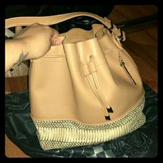 Vince camuto bucket bag Bought 2 years ago and has been sitting in my closet. Comes with dust bag. Some wear on the inside from normal use. Great smooth feel inside is soft leather. no scratches or snags Bags