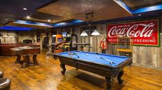 Fizzy Design Rush: Add Some Refreshing Reds With Iconic Coca-Cola Decor in a man cave or game room. Game Room Design, Family Room Design, Epic Man Cave Ideas, Billard Design, Mini Bar At Home, Rustic Games, Pool Table Room, Coca Cola Decor, Game Room Basement