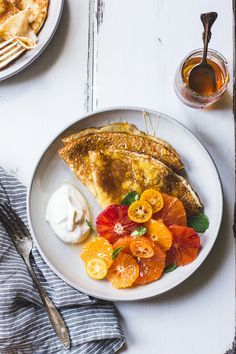 Ricotta Crepes with citrus, honey, and mint.